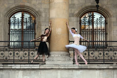 Two graceful ballerinas dancing in a palace Royalty Free Stock Photos
