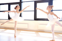 Two graceful little girls practicing ballet Royalty Free Stock Photos