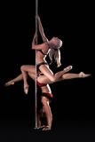 Two graceful young dancers posing on pylon Stock Photos