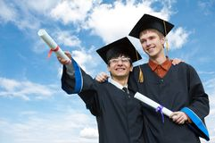 Two graduate students royalty free stock photo