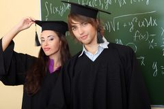 Two graduates Royalty Free Stock Photos