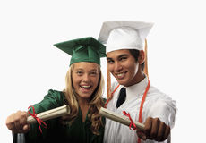 Two graduates in cap and gown Stock Photo