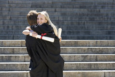 Two graduates embracing Royalty Free Stock Photo