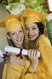Two graduates hugging outside Royalty Free Stock Photo