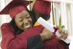Two graduates hugging outside Stock Photography