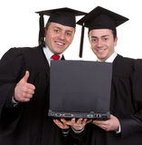 Two graduates Royalty Free Stock Photography