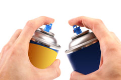 Two graffiti color spray cans in hands Royalty Free Stock Images