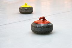Two granite stones for curling game on the ice Stock Photography