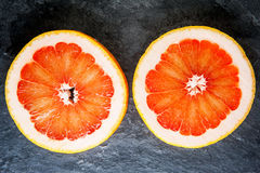 Two grapefruit slices Royalty Free Stock Images