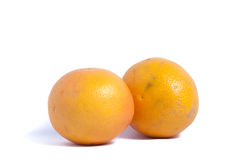 Two grapefruits isolated. On white background close up stock photography
