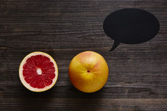 Two grapefruits and a speech bubble Royalty Free Stock Photography