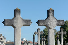 Two grave crosses side by side in cemetery Stock Photos