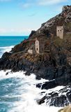 Two Gray Brick Watchtower on Cliff Near Sea at Daytime Stock Photography