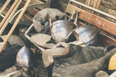 Two Gray Stainless Steel Soldier Helmet on Brown Wooden Bench Royalty Free Stock Images