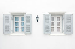 Two Gray windows with blue curtain and pink curtai Royalty Free Stock Image