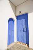 Two Greek blue doors. Royalty Free Stock Photos