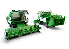 Two Green agricultural combine-harvesters Royalty Free Stock Photos