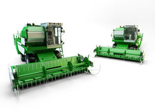 Two Green agricultural combine-harvesters Royalty Free Stock Photo