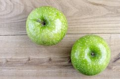 Two green apple over elm wood. Two green apple over wood royalty free stock images