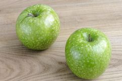 Two green apple over elm wood. Two green apple over wood stock image