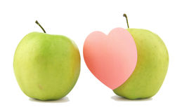 Two green apple with sticker. Two green apple with a pink heart-shaped sticker Royalty Free Stock Images