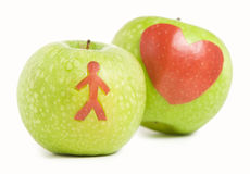 Two green apples. With man and heart silhouette Royalty Free Stock Images