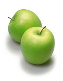 Two green apples. Over white Royalty Free Stock Photo