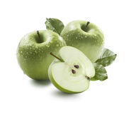 Two green apples and half in water drops isolated on white backg Royalty Free Stock Photography