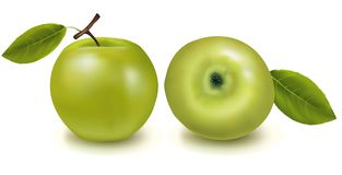 Two green apples with leaves. Stock Photos