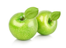 Two green apples with leaves Royalty Free Stock Images