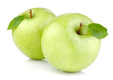 Two green apples with leaves and drops of water Royalty Free Stock Images