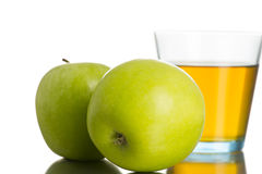 Two green apples next to a glass of apple juice Royalty Free Stock Photography
