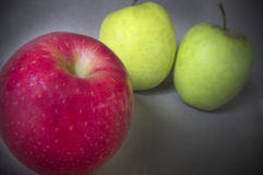 Two Green Apples One Red Stock Image