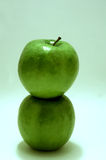 Two Green Apples Stacked. Two stacked tasty, mouth watering fresh green apples Royalty Free Stock Photos