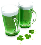 Two green beer's with clovers. For St Patrick's day  on a white background Stock Images