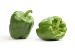 Two green bell pepper. Two fresh green bell pepper, isolated on a white background royalty free stock image
