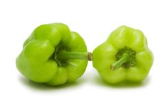 Two green bell peppers. Isolated on white Stock Photography