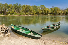 Two boats on the river bank royalty free stock images