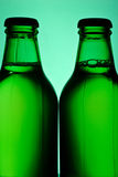 Two green bottles Stock Photo