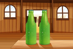 Two green bottles above the table Royalty Free Stock Photos