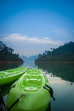 Two green canoes in the lake on twillight time. Royalty Free Stock Image