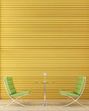 Two green chairs. A table and hours Stock Photos