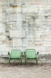 Two green chairs in a Paris park Stock Photo