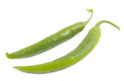 Two green chili peppers on white. Background Stock Images
