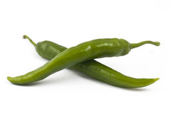 Two green chili peppers on white. Three green chili peppers on white background Stock Images