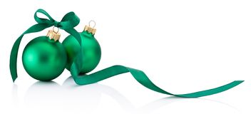 Two green Christmas baubles with ribbon bow isolated on white ba. Two green Christmas baubles with ribbon bow isolated on a white background stock photo