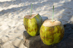 Two Green Coconuts on Rustic Wood Table Stock Photos