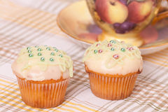 Two green cup cakes Stock Image