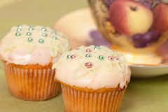Two green cup cakes Stock Images