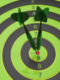 The two green darts hitting the bullseye Royalty Free Stock Images